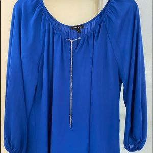 Cocktail Blouse with long sleeve.
